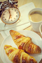 Continental Breakfast Croissant, Coffee & Alarm Clock Royalty Free Stock Photos - 66686258