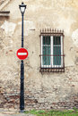 No Entry Sign Hanging On Lamp Post Royalty Free Stock Photos - 66712168