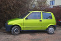 Old Green Fiat Cinquecento Parked Royalty Free Stock Photo - 66721205