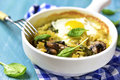 Pasta Baked With Spinach Pesto,egg,mozzarella And Mushrooms In A Stock Image - 66721651