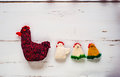 Three Crocheted Easter Chickens And Knitted Hen,white Wooden Bac Royalty Free Stock Photography - 66731527