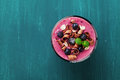 Healthy Breakfast Of Smoothie, Dessert, Yogurt Or Milkshake With Frozen Blueberry And Oats Decorated Grated Chocolate And Mint Royalty Free Stock Photography - 66759357