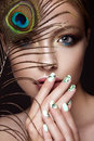 Beautiful Girl With Bright Makeup, Manicure Design And Peacock Feather On Her Face. Art Nails. Stock Photo - 66771100