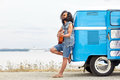 Hippie Man Playing Guitar Over Minivan On Beach Royalty Free Stock Images - 66782529