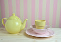 Pink And Yellow Dishes In Kitchen Royalty Free Stock Image - 66786446