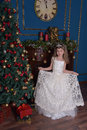 Young Princess In A White Dress With A Tiara On Her Head At The Christmas Tree Stock Photography - 66794122