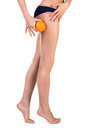 Woman With Orange Showing Cellulite Stock Images - 66811584