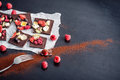 Sweet Chocolate Slices With Fruits On White Paper With Fruit On Plate, Sweet Dessert On Black Background. Image For Patisserie Stock Photos - 66829583