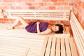 Beautiful Young Female Relaxing In Sauna And Lying On Bench Royalty Free Stock Photography - 66832587