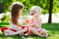 Adorable Little Girls Playing With Paper Moustaches On A Stick And Other Accessories Stock Photo - 66838280