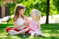 Adorable Little Girls Playing With Paper Moustaches On A Stick And Other Accessories Stock Photos - 66839113