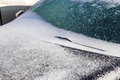 Ice And Snow Cover Windshield And Car Hood After Snow Storm Stock Photo - 66844630