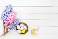 Fresh Hyacinths And Decorative Easter Eggs In Small Nest On White Table. Top View Royalty Free Stock Photos - 66853858