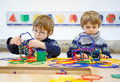 Two Little Kid Boys Building Geometric Figures Royalty Free Stock Image - 66872676