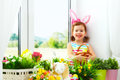 Easter. Happy Child Girl With Bunny Ears And Colorful Eggs Sitti Stock Photography - 66874272