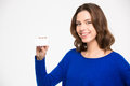 Cheerful Beautiul Young Woman Holding Blank Card And Smiling Stock Image - 66892911