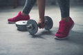 Closeup On Woman Lifting Dumbbell From The Floor Royalty Free Stock Images - 66906679