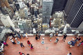 People Taking Pictures From Rooftop On Manhattan Skyscraper Royalty Free Stock Photography - 66920937