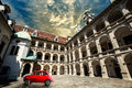Old Vintage Small Red Car In Historical Scene. Klagenfurt Ancient Building Stock Photography - 66925622