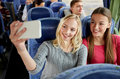 Women Taking Selfie By Smartphone In Travel Bus Royalty Free Stock Images - 66926479
