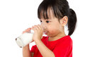 Asian Little Chinese Girl Drinking A Cup Of Milk Royalty Free Stock Photo - 66930925