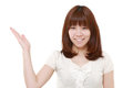 Young Japanese Woman Presenting And Showing Something Royalty Free Stock Photography - 66937237