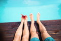 Couple Bare Feet Against Swimming Pool Royalty Free Stock Images - 66959189