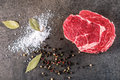 Raw Beef Steak Fillet With Ingredients Like Sea Salt, Pepper And Bay Leaves On Black Board, Image For Restaurant, Royalty Free Stock Photography - 66963607