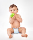 Baby Boy Eating Apple Stock Images - 66965934