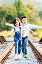 Boy And Girl Walk On The Railway Royalty Free Stock Photography - 66967087