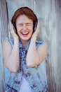 Smiling Hipster Woman Listening To Loud Music Through Headphones Royalty Free Stock Image - 66970316