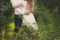 Groom And Bride In A Veil Standing And Holding Hands Stock Images - 66986174