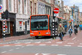 Riding A Bike People And Big Bus In Haarlem Royalty Free Stock Photography - 66990857