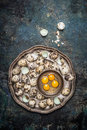 Quail Eggs In Metal Plate On Rustic Background Stock Photo - 66992670