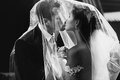 Happy Newlywed Couple Kissing Bride And Handsome Groom Under Vei Stock Images - 67003594