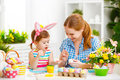 Happy Family Mother And Child Girl Paints Eggs For Easter Royalty Free Stock Images - 67033719