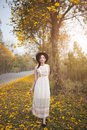 Asian Pretty Girl Surrounded By The Yellow Flowers In Summer Royalty Free Stock Photography - 67074877