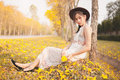 Asian Pretty Girl Surrounded By The Yellow Flowers In Summer Stock Photo - 67074930