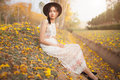 Asian Pretty Girl Surrounded By The Yellow Flowers In Summer Stock Photo - 67074980