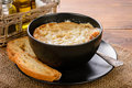 French Onion Soup With Toasts On Wooden Table. Stock Photo - 67084780