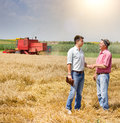 Men In The Wheat Field At Harvest Stock Photo - 67095620