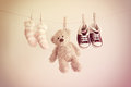 Colorful Background For Baby Girl With Two Pink Socks, Sneakers And Teddy Bear With Copy Space. Stock Photo - 67125030