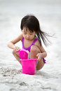 Asian Little Chinese Girl Playing Sand With Beach Toys Stock Photo - 67137260