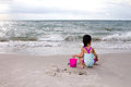 Asian Little Chinese Girl Playing Sand With Beach Toys Stock Photos - 67146663