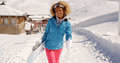 Smiling Pretty Young Woman Carrying A Snowboard Stock Photo - 67148900
