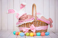 Newborn Baby Girl In A Rabbit Costume Has Sweet Dreams On The Wicker Basket. Easter Holiday Stock Image - 67173181
