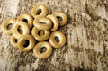 Bunch Of Bagels Horizontally On Brown Background. Stock Photography - 67192182