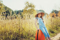 Happy Child Girl With Orange Suitcase Traveling Alone On Summer Vacation. Kid Going To Summer Camp. Royalty Free Stock Images - 67214109
