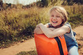 Happy Child Girl With Orange Suitcase Traveling Alone On Summer Vacation. Kid Going To Summer Camp. Stock Images - 67214144