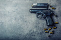 9 Mm Pistol Gun And Bullets Strewn On The Table Royalty Free Stock Photo - 67223925